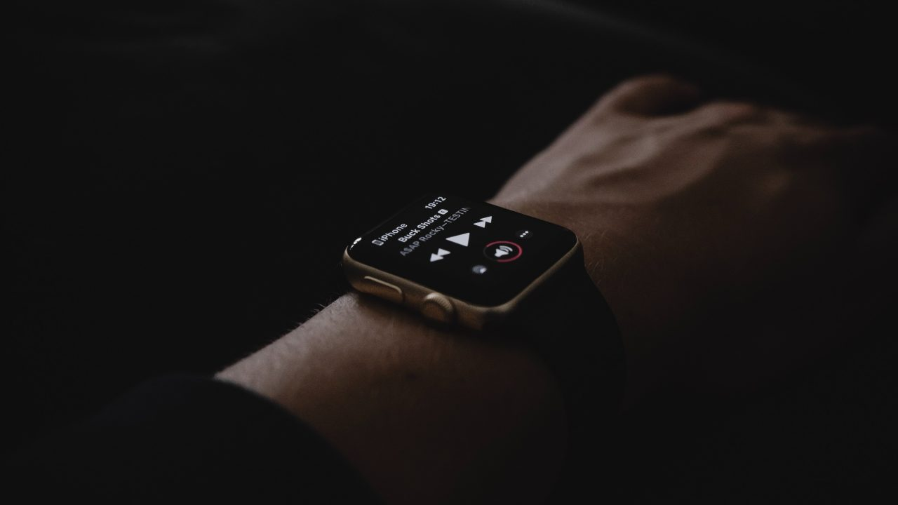 person wearing gold Apple Watch