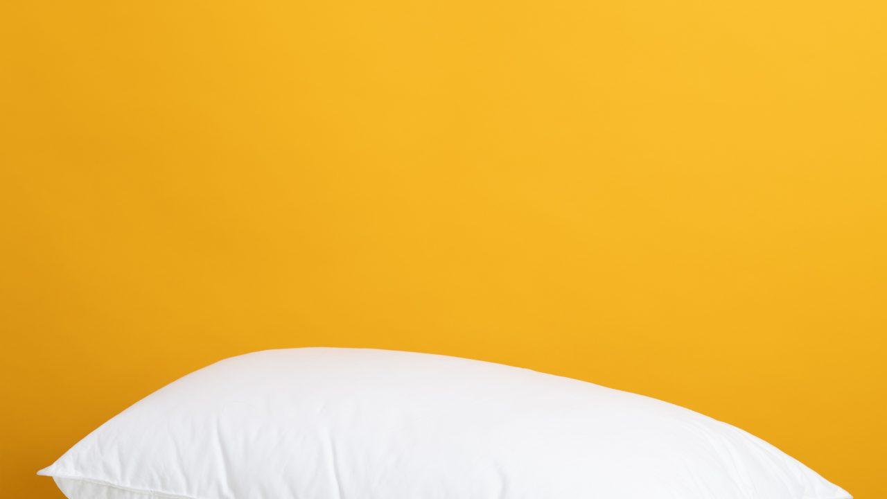 white pillow on white bed