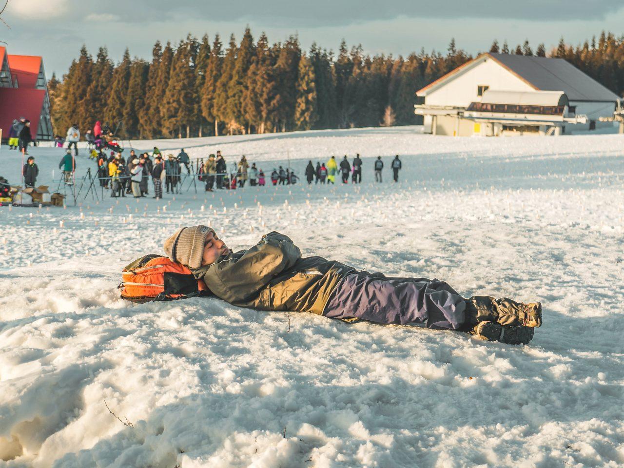man sleeping on snow