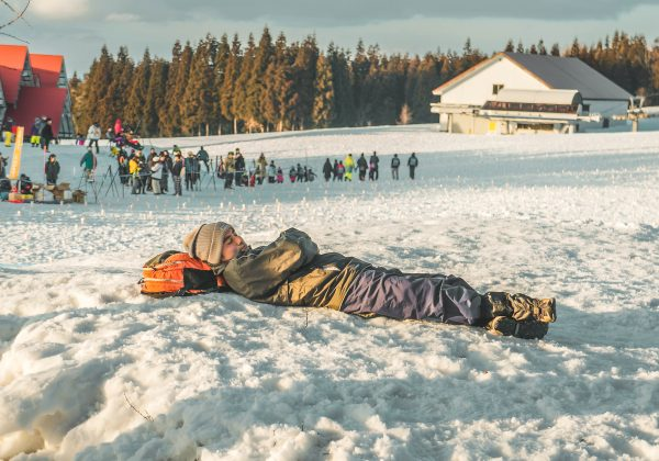 man sleeping on snow