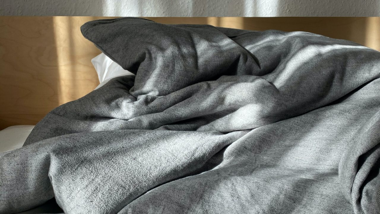gray textile on brown couch